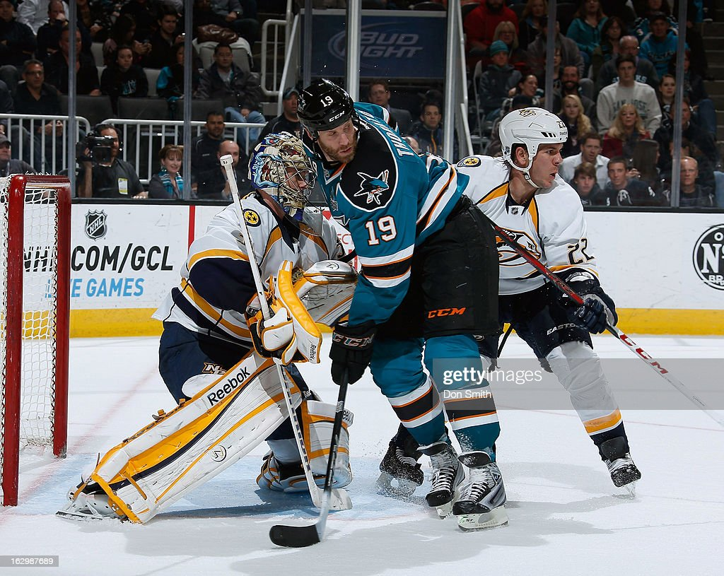 <a gi-track='captionPersonalityLinkClicked' href=/galleries/search?phrase=Joe+Thornton&family=editorial&specificpeople=201829 ng-click='$event.stopPropagation()'>Joe Thornton</a> #19 of the San Jose Sharks creates traffic in front of the net against <a gi-track='captionPersonalityLinkClicked' href=/galleries/search?phrase=Pekka+Rinne&family=editorial&specificpeople=2118342 ng-click='$event.stopPropagation()'>Pekka Rinne</a> #35 and <a gi-track='captionPersonalityLinkClicked' href=/galleries/search?phrase=Scott+Hannan&family=editorial&specificpeople=203195 ng-click='$event.stopPropagation()'>Scott Hannan</a> #22 of the Nashville Predators during an NHL game on March 2, 2013 at HP Pavilion in San Jose, California.