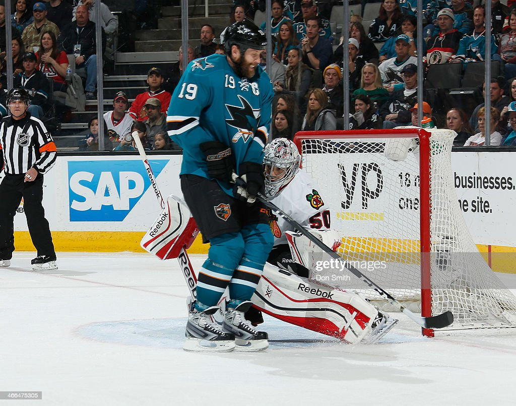 Joe Thornton #19 of the San Jose Sharks creates traffic in front of the net against Corey Crawford #50 of the Chicago Blackhawks during an NHL game on February 1, 2014 at SAP Center in San Jose, California.
