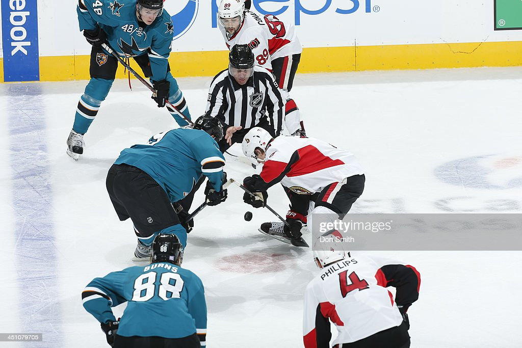 Joe Thornton of the San Jose Sharks faces off against Kyle Turris of the Ottawa Senators during an NHL game on October 12 2013 at SAP Center in San...