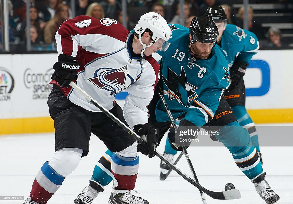 <a gi-track='captionPersonalityLinkClicked' href=/galleries/search?phrase=Joe+Thornton&family=editorial&specificpeople=201829 ng-click='$event.stopPropagation()'>Joe Thornton</a> #19 of the San Jose Sharks faces-off against <a gi-track='captionPersonalityLinkClicked' href=/galleries/search?phrase=Matt+Duchene&family=editorial&specificpeople=4819304 ng-click='$event.stopPropagation()'>Matt Duchene</a> #9 of the Colorado Avalanche during an NHL game on December 23, 2013 at SAP Center in San Jose, California.