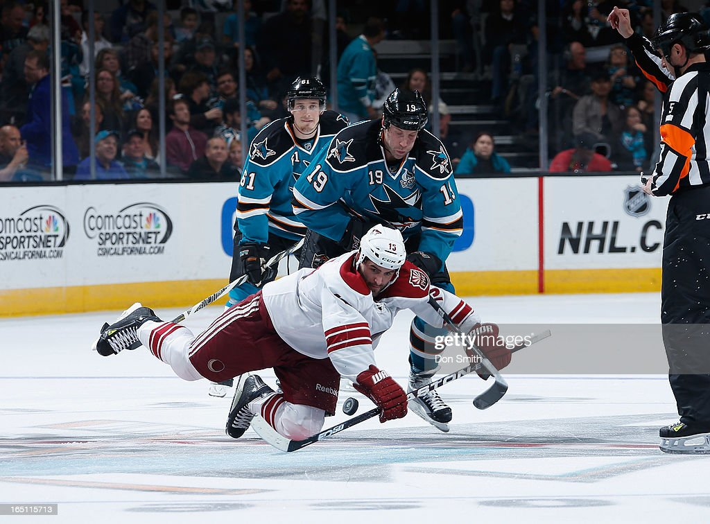 <a gi-track='captionPersonalityLinkClicked' href=/galleries/search?phrase=Joe+Thornton&family=editorial&specificpeople=201829 ng-click='$event.stopPropagation()'>Joe Thornton</a> #19 of the San Jose Sharks fights for the puck against <a gi-track='captionPersonalityLinkClicked' href=/galleries/search?phrase=Boyd+Gordon&family=editorial&specificpeople=209395 ng-click='$event.stopPropagation()'>Boyd Gordon</a> #15 of the Phoenix Coyotes during an NHL game on March 30, 2013 at HP Pavilion in San Jose, California.