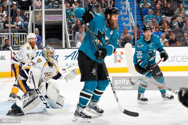 Joe Thornton of the San Jose Sharks gets in front of Juuse Saros of the Nashville Predators during a NHL game at SAP Center at San Jose on March 11...