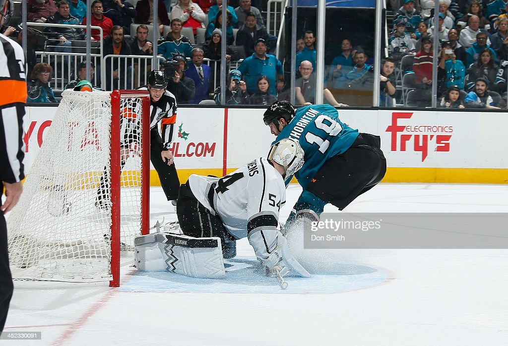 Joe Thornton #19 of the San Jose Sharks gets the game winning goal in the shootout against Ben Scrivens #54 of the Los Angeles Kings during an NHL game on November 27, 2013 at SAP Center in San Jose, California.