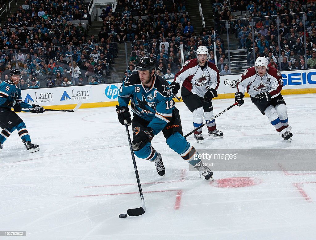 <a gi-track='captionPersonalityLinkClicked' href=/galleries/search?phrase=Joe+Thornton&family=editorial&specificpeople=201829 ng-click='$event.stopPropagation()'>Joe Thornton</a> #19 of the San Jose Sharks handles the puck against <a gi-track='captionPersonalityLinkClicked' href=/galleries/search?phrase=Paul+Stastny&family=editorial&specificpeople=2494330 ng-click='$event.stopPropagation()'>Paul Stastny</a> #26 and <a gi-track='captionPersonalityLinkClicked' href=/galleries/search?phrase=Jan+Hejda&family=editorial&specificpeople=624333 ng-click='$event.stopPropagation()'>Jan Hejda</a> #8 of the Colorado Avalanche during an NHL game on February 26, 2013 at HP Pavilion in San Jose, California.