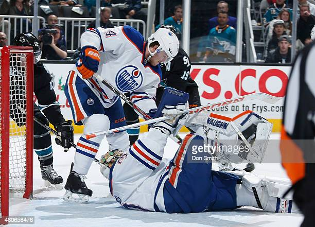 Joe Thornton of the San Jose Sharks looks for a rebound against Ben Scrivens and Oscar Klefblom of the Edmonton Oilers during an NHL game on December...