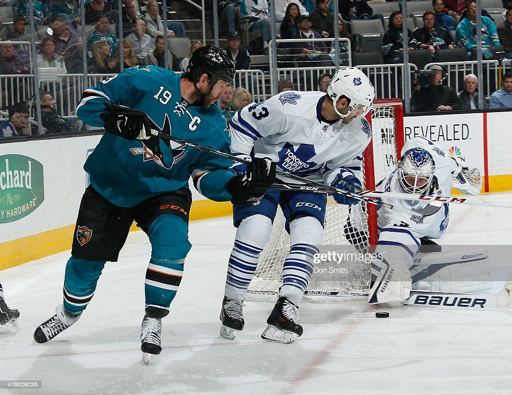 <a gi-track='captionPersonalityLinkClicked' href=/galleries/search?phrase=Joe+Thornton&family=editorial&specificpeople=201829 ng-click='$event.stopPropagation()'>Joe Thornton</a> #19 of the San Jose Sharks looks for a rebound against James Reimer #34 and <a gi-track='captionPersonalityLinkClicked' href=/galleries/search?phrase=Nazem+Kadri&family=editorial&specificpeople=4043234 ng-click='$event.stopPropagation()'>Nazem Kadri</a> #43 of the Toronto Maple Leafs during an NHL game on March 11, 2014 at SAP Center in San Jose, California.