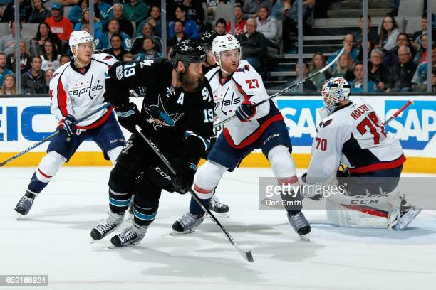Joe Thornton of the San Jose Sharks looks for the puck as John Carlson Karl Alzner and Braden Holtby of the Washington Capitals defend at SAP Center...