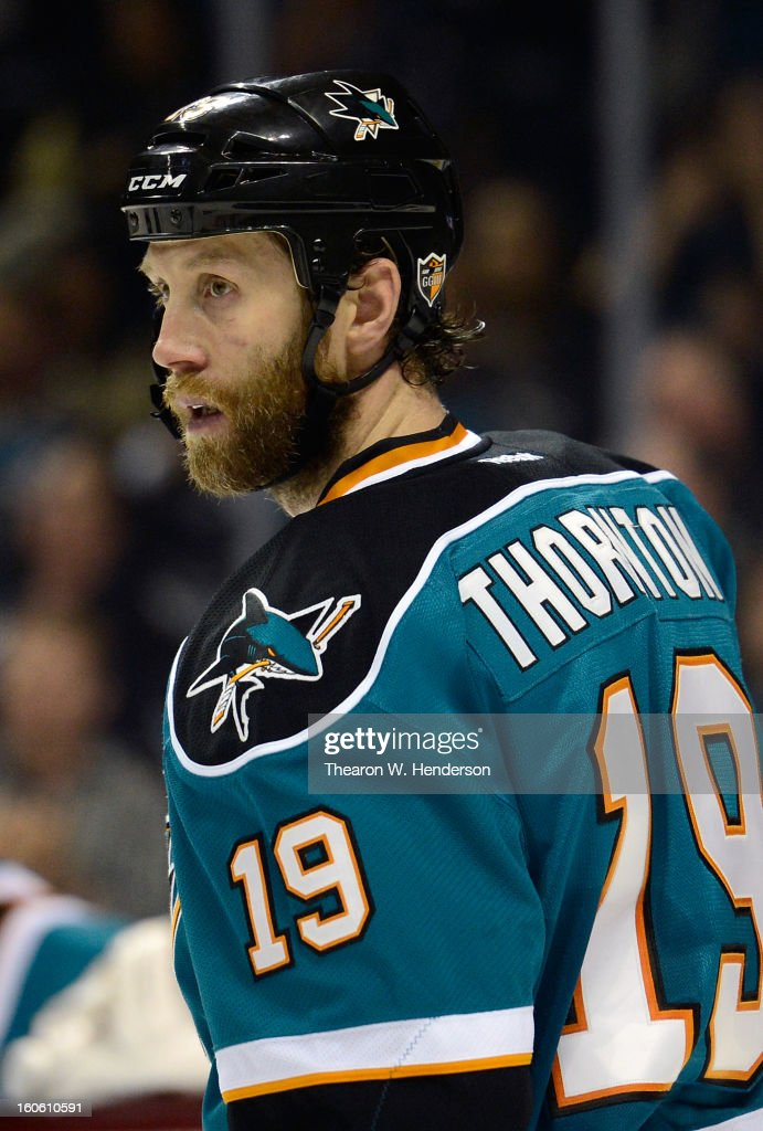Joe Thornton #19 of the San Jose Sharks looks on during a break in the action against the Nashville Predators at HP Pavilion on February 2, 2013 in San Jose, California. The Predators won the game in an overtime shoot-out 2-1.