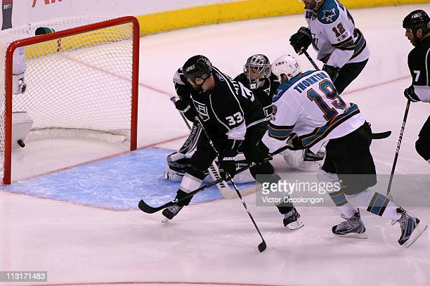 Joe Thornton of the San Jose Sharks scores the game winning goal against the Los Angeles Kings in game six of the Western Conference Quarterfinals to...