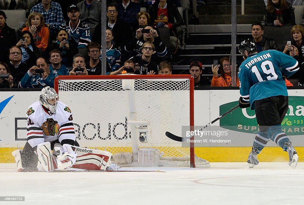 <a gi-track='captionPersonalityLinkClicked' href=/galleries/search?phrase=Joe+Thornton&family=editorial&specificpeople=201829 ng-click='$event.stopPropagation()'>Joe Thornton</a> #19 of the San Jose Sharks scores the winning goal against goalkeeper <a gi-track='captionPersonalityLinkClicked' href=/galleries/search?phrase=Corey+Crawford&family=editorial&specificpeople=818935 ng-click='$event.stopPropagation()'>Corey Crawford</a> #50 of the Chicago Blackhawks during an overtime shoot-out at SAP Center on February 1, 2014 in San Jose, California. The sharks won the game 2-1.