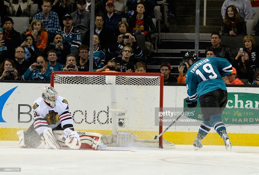 Joe Thornton #19 of the San Jose Sharks scores the winning goal getting his shot past goalkeeper Corey Crawford #50 of the Chicago Blackhawks during an overtime shoot-out at SAP Center on February 1, 2014 in San Jose, California. The sharks won the game 2-1.