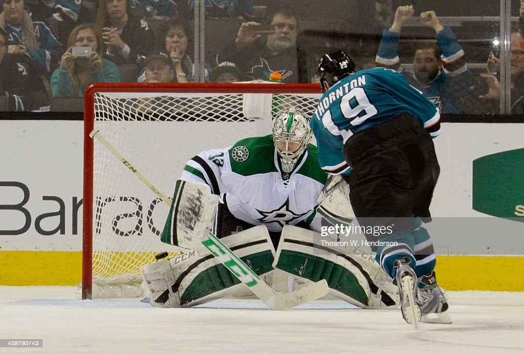 <a gi-track='captionPersonalityLinkClicked' href=/galleries/search?phrase=Joe+Thornton&family=editorial&specificpeople=201829 ng-click='$event.stopPropagation()'>Joe Thornton</a> #19 of the San Jose Sharks scores the winning goal in an overtime shoot-out, getting his shot past goalkeeper <a gi-track='captionPersonalityLinkClicked' href=/galleries/search?phrase=Kari+Lehtonen&family=editorial&specificpeople=211612 ng-click='$event.stopPropagation()'>Kari Lehtonen</a> #32 of the Dallas Stars at SAP Center on December 21, 2013 in San Jose, California. The Sharks won the game 3-2.