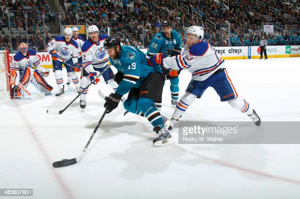 Joe Thornton of the San Jose Sharks skates after the puck against Anton Lander of the Edmonton Oilers at SAP Center on April 1 2014 in San Jose...