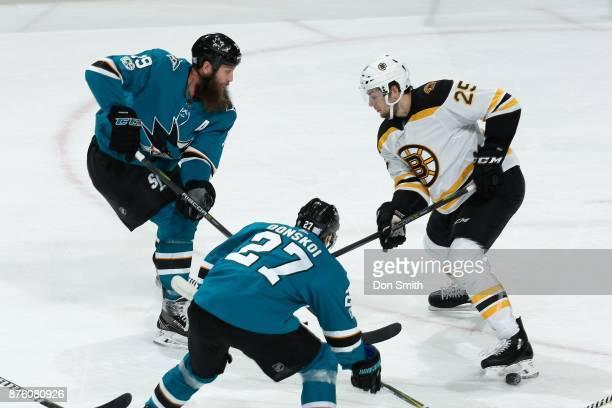 Joe Thornton of the San Jose Sharks skates against Brandon Carlo of the Boston Bruins at SAP Center on November 18 2017 in San Jose California