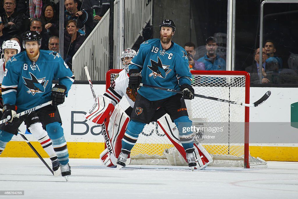 Joe Thornton #19 of the San Jose Sharks skates in front of Corey Crawford #50 of the Chicago Blackhawks at SAP Center on February 1, 2014 in San Jose, California.