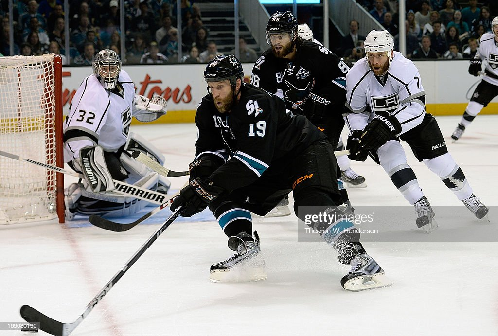 Joe Thornton #19 of the San Jose Sharks skates to gain control of the puck ahead of Rob Scuderi #7 of the Los Angeles Kings in the second period in Game Three of the Western Conference Semifinals during the 2013 NHL Stanley Cup Playoffs at HP Pavilion on May 18, 2013 in San Jose, California. The Sharks defeated the Kings in overtime 2-1.