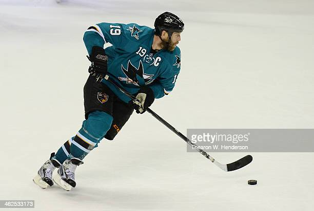 Joe Thornton of the San Jose Sharks skates up ice with control of the puck against the Boston Bruins during the third period at SAP Center on January...