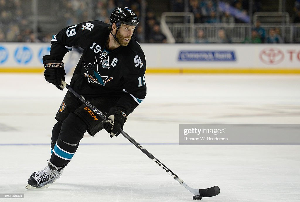 Joe Thornton #19 of the San Jose Sharks skates with control of the puck against the Vancouver Canucks at HP Pavilion on January 27, 2013 in San Jose, California.