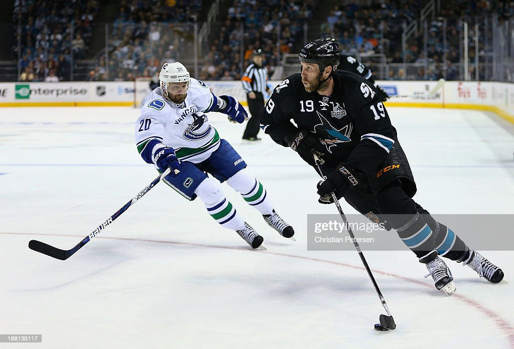 Joe Thornton #19 of the San Jose Sharks skates with the puck ahead of Chris Higgins #20 of the Vancouver Canucks in Game Three of the Western Conference Quarterfinals during the 2013 NHL Stanley Cup Playoffs at HP Pavilion on May 5, 2013 in San Jose, California. The Sharks defeated the Canucks 5-2.