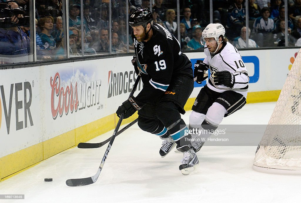 Joe Thornton #19 of the San Jose Sharks skates with the puck ahead of Mike Richards #10 of the Los Angeles Kings in the second period in Game Four of the Western Conference Semifinals during the 2013 NHL Stanley Cup Playoffs at HP Pavilion on May 21, 2013 in San Jose, California.