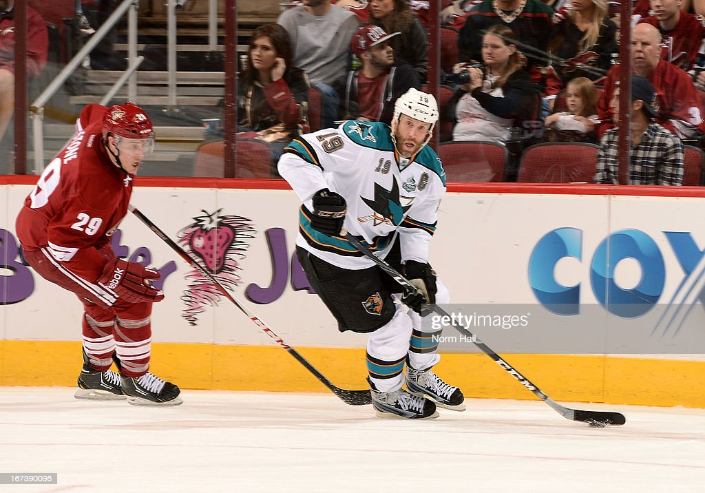 <a gi-track='captionPersonalityLinkClicked' href=/galleries/search?phrase=Joe+Thornton&family=editorial&specificpeople=201829 ng-click='$event.stopPropagation()'>Joe Thornton</a> #19 of the San Jose Sharks skates with the puck around the defense of Michael Stone #29 of the Phoenix Coyotes during the third period at Jobing.com Arena on April 24, 2013 in Glendale, Arizona.