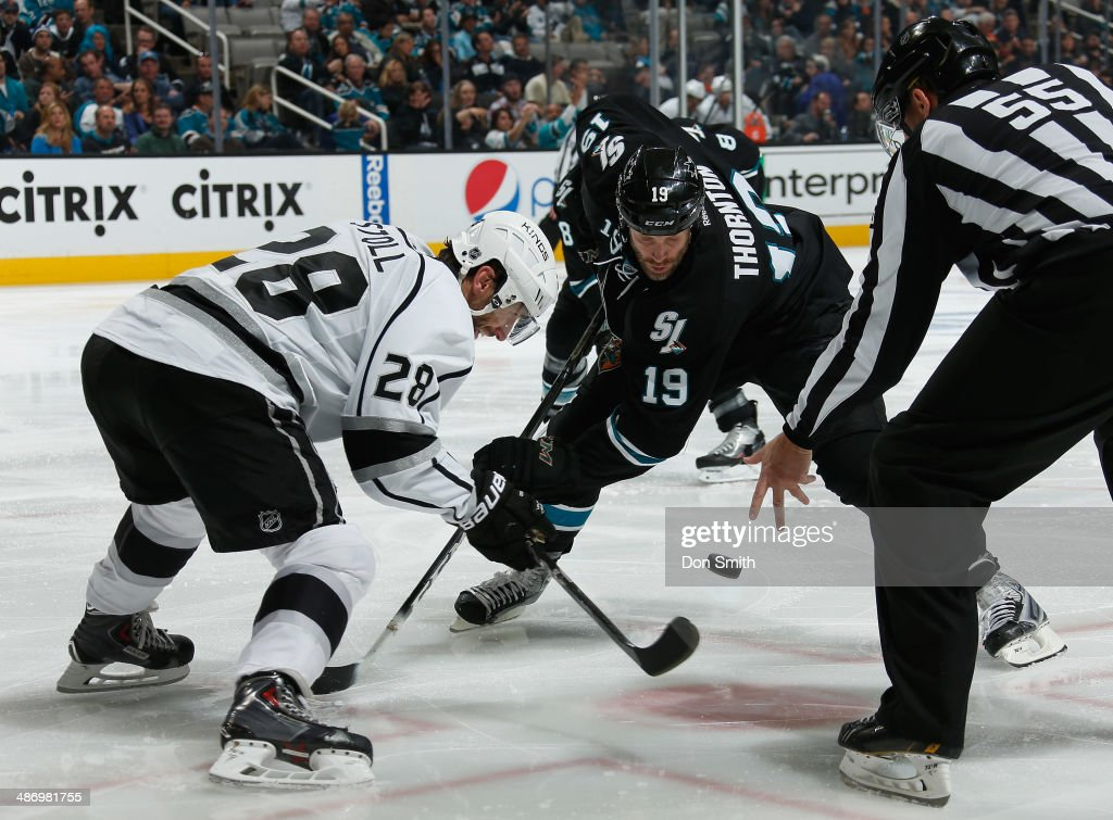 <a gi-track='captionPersonalityLinkClicked' href=/galleries/search?phrase=Joe+Thornton&family=editorial&specificpeople=201829 ng-click='$event.stopPropagation()'>Joe Thornton</a> #19 of the San Jose Sharks takes a face-off against <a gi-track='captionPersonalityLinkClicked' href=/galleries/search?phrase=Jarret+Stoll&family=editorial&specificpeople=204632 ng-click='$event.stopPropagation()'>Jarret Stoll</a> #28 of the Los Angeles Kings in Game Five of the First Round of the 2014 Stanley Cup Playoffs at SAP Center on April 26, 2014 in San Jose, California.
