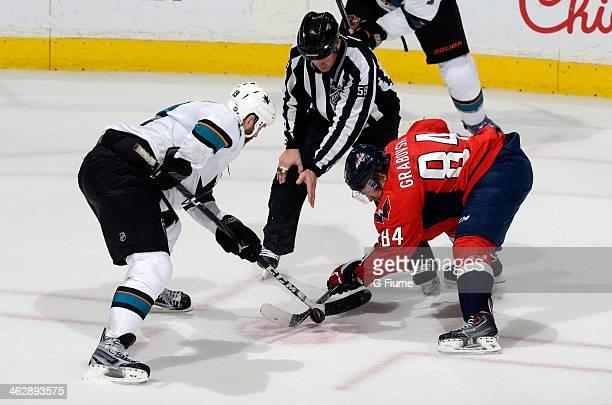 Joe Thornton of the San Jose Sharks takes a faceoff against Mikhail Grabovski of the Washington Capitals at the Verizon Center on January 14 2014 in...