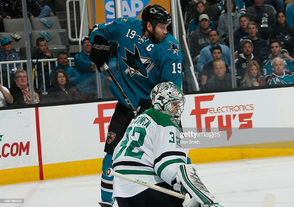 Joe Thornton #19 of the San Jose Sharks tries to cover the net against Keri Lehtonen #32 of the Dallas Stars during an NHL game on December 21, 2013 at SAP Center in San Jose, California.