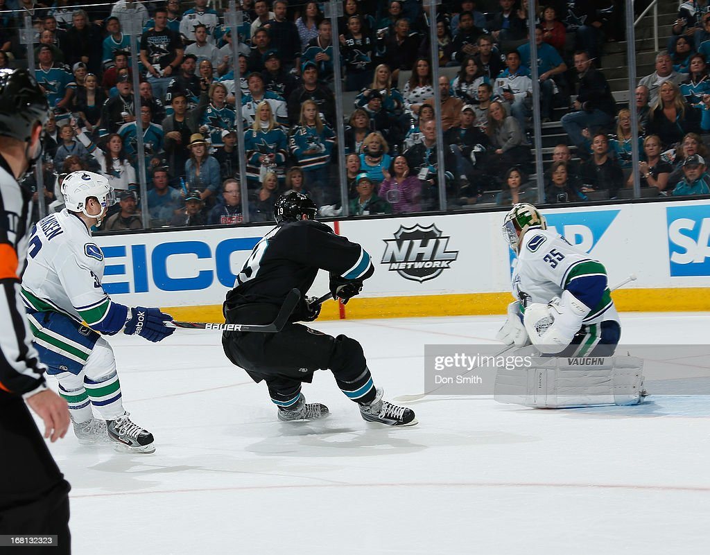 Joe Thornton #19 of the San Jose Sharks tries to score on a break away against Cory Schneider #35 of the Vancouver Canucks in Game One of the Western Conference Quarterfinals during the 2013 Stanley Cup Playoffs at HP Pavilion on May 5, 2013 in San Jose, California.