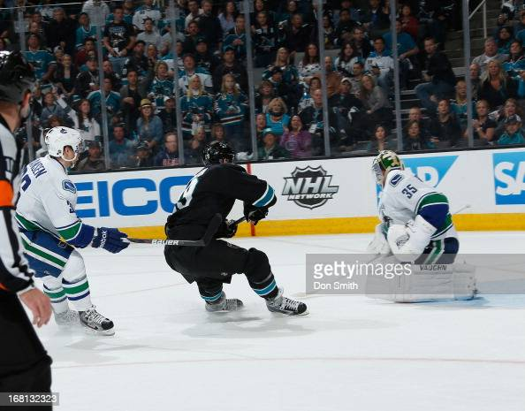 Joe Thornton of the San Jose Sharks tries to score on a break away against Cory Schneider of the Vancouver Canucks in Game One of the Western...