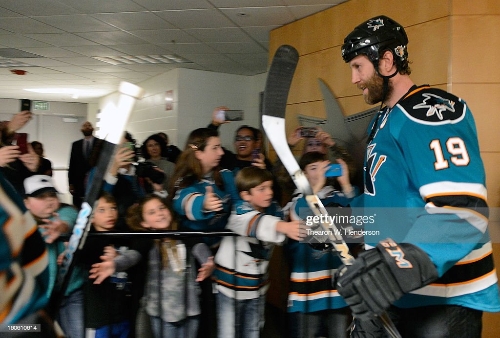 Joe Thornton #19 of the San Jose Sharks walking out of the locker room slapps hands with fans before the start of his game against the Nashville Predators at HP Pavilion on February 2, 2013 in San Jose, California.