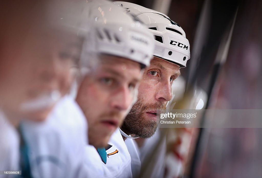 Joe Thornton #19 of the San Jose Sharks watches from the bench during the preseason NHL game against the Phoenix Coyotes at Jobing.com Arena on September 27, 2013 in Glendale, Arizona.