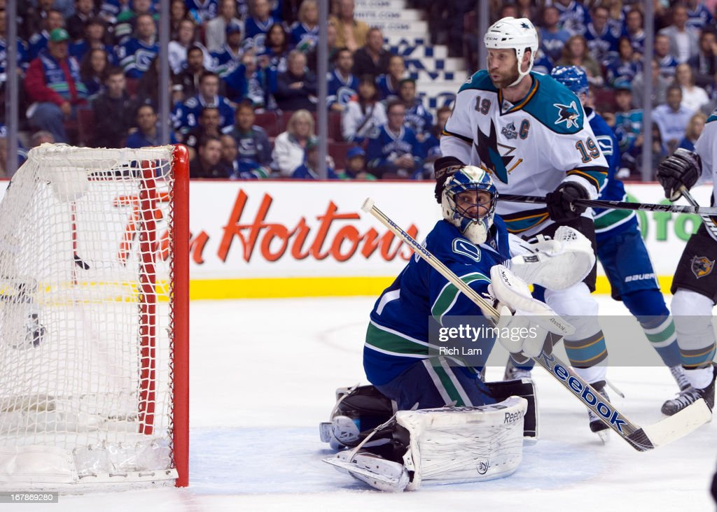 <a gi-track='captionPersonalityLinkClicked' href=/galleries/search?phrase=Joe+Thornton&family=editorial&specificpeople=201829 ng-click='$event.stopPropagation()'>Joe Thornton</a> #19 of the San Jose Sharks watches the puck hit the back of the net behind goalie <a gi-track='captionPersonalityLinkClicked' href=/galleries/search?phrase=Roberto+Luongo&family=editorial&specificpeople=202638 ng-click='$event.stopPropagation()'>Roberto Luongo</a> #1 of the Vancouver Canucks during the second period in Game One of the Western Conference Quarterfinals of the 2013 NHL Stanley Cup Playoffs, May 01, 2013 at Rogers Arena in Vancouver, British Columbia, Canada. Logan Couture #39 of the San Jose Sharks was credited with the goal.