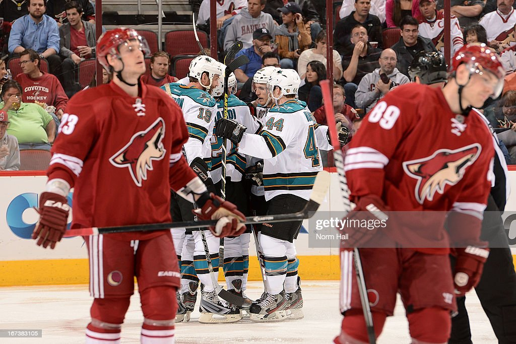 <a gi-track='captionPersonalityLinkClicked' href=/galleries/search?phrase=Joe+Thornton&family=editorial&specificpeople=201829 ng-click='$event.stopPropagation()'>Joe Thornton</a> #19, TJ Galiardi #21, <a gi-track='captionPersonalityLinkClicked' href=/galleries/search?phrase=Marc-Edouard+Vlasic&family=editorial&specificpeople=880807 ng-click='$event.stopPropagation()'>Marc-Edouard Vlasic</a> #44 and <a gi-track='captionPersonalityLinkClicked' href=/galleries/search?phrase=Matt+Tennyson&family=editorial&specificpeople=9030143 ng-click='$event.stopPropagation()'>Matt Tennyson</a> #80 of the San Jose Sharks celebrate the second period goal of teammate <a gi-track='captionPersonalityLinkClicked' href=/galleries/search?phrase=Brent+Burns&family=editorial&specificpeople=212883 ng-click='$event.stopPropagation()'>Brent Burns</a> #88 as <a gi-track='captionPersonalityLinkClicked' href=/galleries/search?phrase=Oliver+Ekman-Larsson&family=editorial&specificpeople=5894618 ng-click='$event.stopPropagation()'>Oliver Ekman-Larsson</a> #23 and <a gi-track='captionPersonalityLinkClicked' href=/galleries/search?phrase=Mikkel+Boedker&family=editorial&specificpeople=4697252 ng-click='$event.stopPropagation()'>Mikkel Boedker</a> #89 of the Phoenix Coyotes skate to the bench at Jobing.com Arena on April 24, 2013 in Glendale, Arizona.