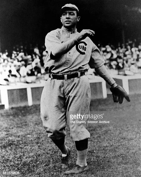 Joe Tinker shortstop for the 1910 Chicago Cubs in full on the road uniform throws the ball circa 1910