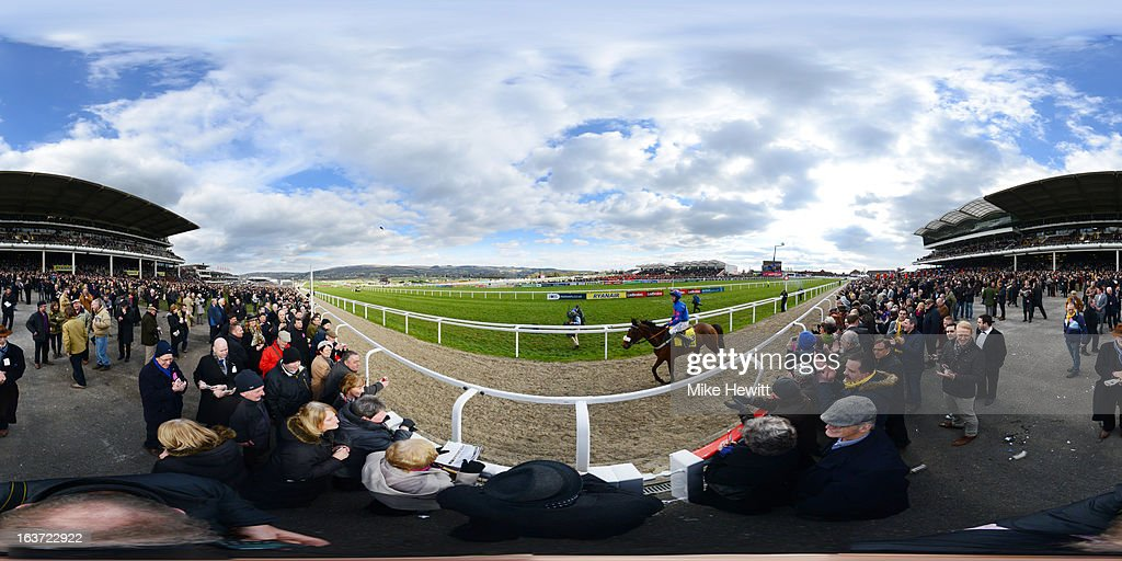 <a gi-track='captionPersonalityLinkClicked' href=/galleries/search?phrase=Joe+Tizzard&family=editorial&specificpeople=194760 ng-click='$event.stopPropagation()'>Joe Tizzard</a> riding Cue Card return to the winners enclosure after victory in The Ryanair Steeple Chase during St Patrick's Thursday at Cheltenham racecourse on March 14, 2013 in Cheltenham, England.