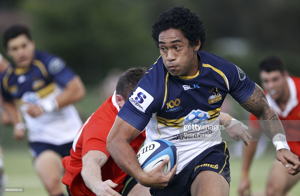 Joe Tomane of the Brumbies runs the ball during the Super Rugby trial match between the Brumbies and the ACT XV at Viking Park on February 8, 2013 in Canberra, Australia.