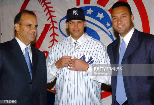 Joe Torre Alex Rodriguez and Derek Jeter during Alex Rodriguez Signs wit h The New York Yankees Press Conference at Yankee Stadium in New York City...
