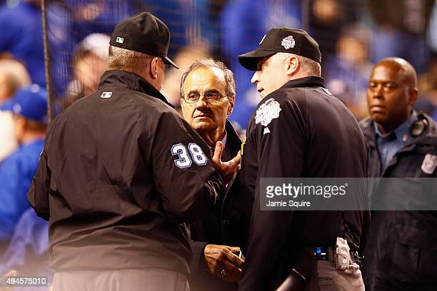 Joe Torre Major League Baseball's Chief Baseball Officer meets with umpires in the fourth inning to discuss technical difficulties during Game One of...