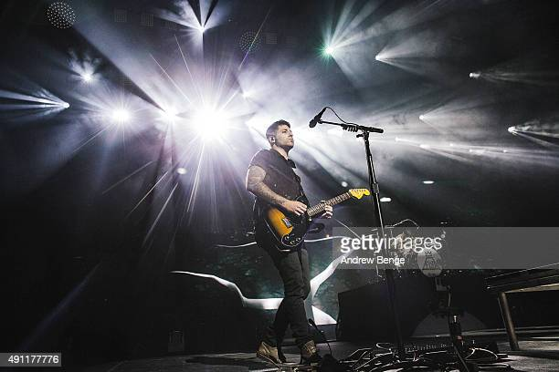 Joe Trohman of Fall Out Boy performs on stage at First Direct Arena on October 3 2015 in Leeds England