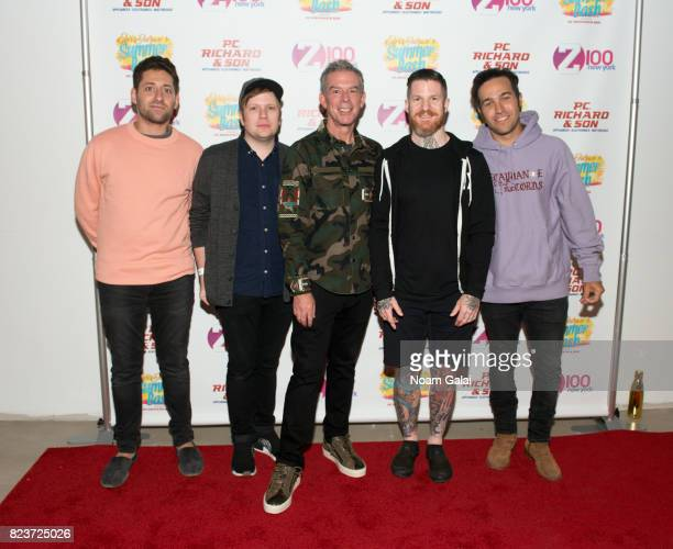 Joe Trohman Patrick Stump Andy Hurley and Pete Wentz of Fall Out Boy pose with Elvis Duran at Elvis Duran's 2017 Summer Bash at the Pennsy Plaza on...
