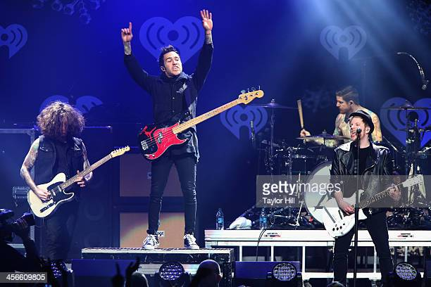 Joe Trohman Pete Wentz Andy Hurley and Patrick Stump of Fall Out Boy perform onstage during KISS 108's Jingle Ball 2013 at TD Garden on December 14...