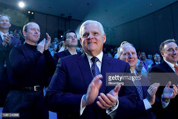 Joe Tucci chairman and chief executive officer of EMC Corp applauds during a media event in New York US on Tuesday Jan 18 2011 EMC today introduced...