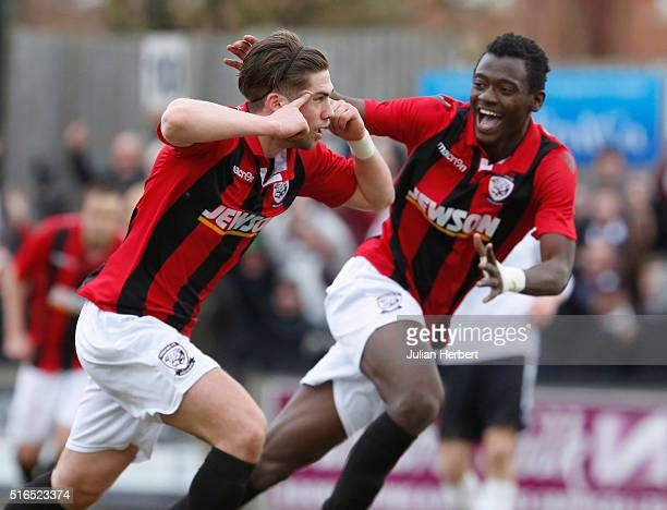 Joe Tumelty Mustapha Bundu of Hereford celebrate a goal during the FA Vase Semi Final Second Leg Match between Salisbury and Hereford at The Ray Mac...