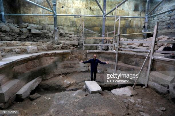 Joe Uziel an archeologist from the Israeli Antiquity Authority shows journalists a recently discovered ancient roman theatre from the second...