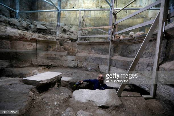 Joe Uziel an archeologist from the Israeli Antiquity Authority works on a recently discovered ancient roman theatre from the second sanctuary that...