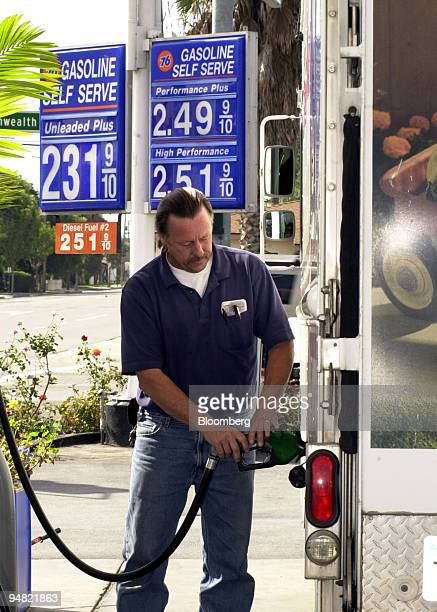 Joe Van Dieren pumps diesel gasoline priced at $2519 into his truck Monday morning March 21 2005 at Bob's 76 Service station in Fullerton California...
