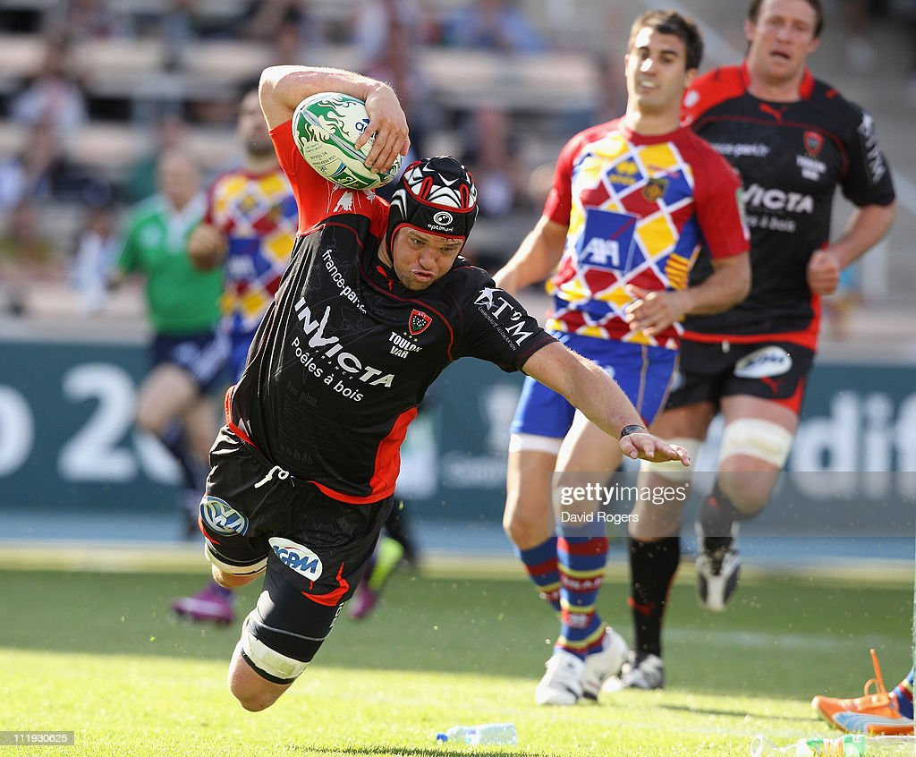 <a gi-track='captionPersonalityLinkClicked' href=/galleries/search?phrase=Joe+van+Niekerk&family=editorial&specificpeople=225015 ng-click='$event.stopPropagation()'>Joe van Niekerk</a> of Toulon dives over for a try during the Heineken Cup quarter final match between Perpignan and Toulon at the Olympic Stadium on April 9, 2011 in Barcelona, Spain.