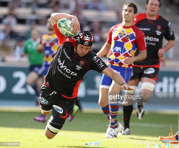 Joe van Niekerk of Toulon dives over for a try during the Heineken Cup quarter final match between Perpignan and Toulon at the Olympic Stadium on...