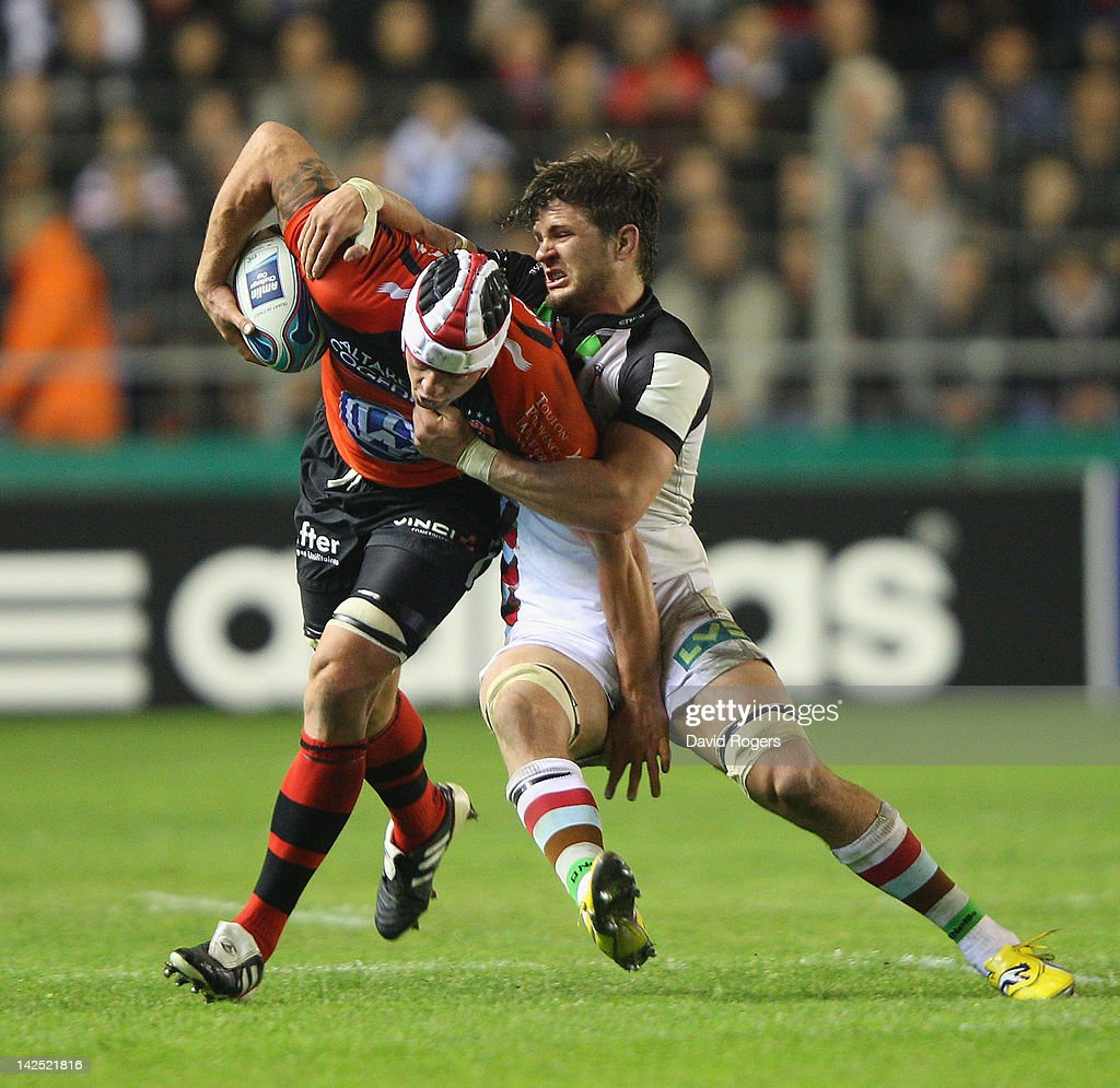 <a gi-track='captionPersonalityLinkClicked' href=/galleries/search?phrase=Joe+van+Niekerk&family=editorial&specificpeople=225015 ng-click='$event.stopPropagation()'>Joe van Niekerk</a> of Toulon is tackled by Luke Wallace during the Amlin Challenge Cup quarter final match between Toulon and Harlequins at Stade Felix Mayol on April 6, 2012 in Toulon, France.